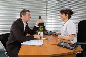 pic of prophylactic  - a Pharmaceutical Sales Representative at hospital with a doctor - JPG