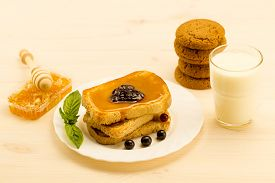 picture of french toast  - fresh french toast with honey and jam on a white plate with berries - JPG