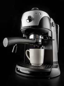 stock photo of mug shot  - Modern coffee machine with white mug shot on black background - JPG
