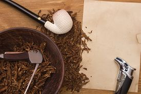 image of tobacco-pipe  - Tobacco for pipe and pipe smoker tools and scraper - JPG
