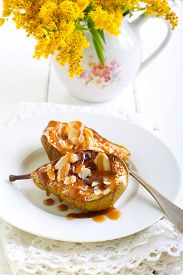stock photo of toffee  - Toffee pears with almonds served on plate - JPG