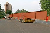 image of oversize load  - A huge steel beam for bridge construction on a truck - JPG