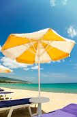 Bright umbrellas and chairs on beautiful tropical beach