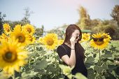 Beauty Joyful Teenage Girl With Sunflower Enjoying Nature And Laughing On Summer Sunflower Field. Su poster