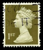 UNITED KINGDOM - CIRCA 1974: An English Used First Class Postage Stamp showing Portrait of Queen Elizabeth in light gold circa 1974.