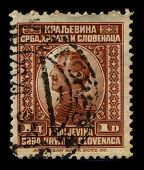 YUOGOSLAVIA -CIRCA 1920:A stamp printed in YUOGOSLAVIA shows image of Alexander I was the first king