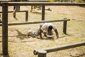 Military soldiers training on fitness trail at boot camp poster