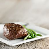 steak with green beans and copyspace