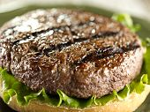 juicy hamburger patty closeup  (note-selective focus)
