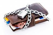 Leather wallet with credit cards and Euro currency locked with a chain and combination lock, isolate