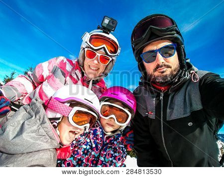 poster of Family Enjoying Winter Vacations Taking Selfie In Skiing Gear. Family With Children On Skiing Vacati