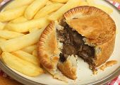 Individual steak & kidney pie with chips.