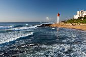 lighthouse in morning sunlight in Umhlanga beach, Durban, South Africa