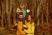 Wife And Husband With Little Baby Son Enjoy Sunny Day In Park, Genetic Relationship. Family Relation poster