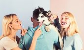 Play With Your Dog To Help Him Live To His Fullest. Happy Family Have Fun With Husky Dog. Happy Wome poster