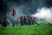stock photo of yanks  - SEATTLE - JUL 10 - Union artillery fires their gun in a Civil War battle reenactment on July 10 1996 near Seattle.