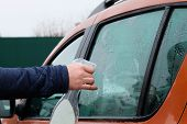 Man Cleaning His Orange Automobile With Spray. Washing Automobile Window. Drops On Glass. poster