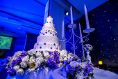 Cake For Wedding Day.wedding Cake With Stage Lighting In Wedding Ceremony.white Cake And Candle For  poster