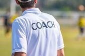 Back View Of Male Sport Coach In Coach Shirt At An Outdoor Sport Field, Good For Sport Or Coaching C poster