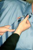 Woman Adjusting Tie
