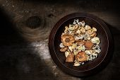 Potpourri - Close-up Of A Bowl With Scented Dry Plants And Petals On A Wooden Background With Copy S poster