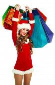 Retrato de una mujer joven sexy vestido como Santa con muchas bolsas