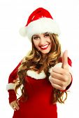 beautiful young blond woman dressed as Santa with her thumb up