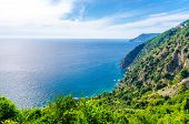 Aerial Top Panoramic View Of Green Hills, Rocks, Cliffs And Gulf Of Genoa, Ligurian Sea, Coastline O poster