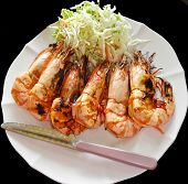 6 Baked Shrimp, Arranged In A Row On A Plate Dressed With A Salad. Isolated