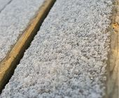 Snow On The Wood Surface. Background
