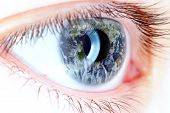 Blue Eye In Macro With Earth Map