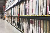 Many Different Colored Wallpapers In The Supermarket Showcase. Choice Of Wallpapers In A Warehouse.  poster