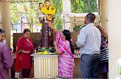Praying At Statue of Jesus, India