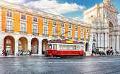 Lisbon, Portugal. Red touristic tram at Praca do Comercio (Commercial Square) near Triumphal Arch of poster