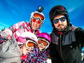 Family Enjoying Winter Vacations Taking Selfie In Skiing Gear. Family With Children On Skiing Vacati poster