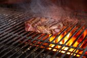 A Top Sirloin Steak Flame Broiled On A Barbecue, Shallow Depth Of Field. poster