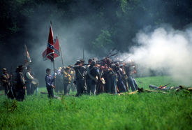 image of rebs  - SEATTLE - JUL 10 - Union artillery fires their gun in a Civil War battle reenactment on July 10 1996 near Seattle. ** Note: Slight graininess, best at smaller sizes - JPG