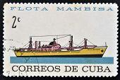 CUBA - CIRCA 1962: A stamp printed in Cuba dedicated to Mambisa fleet shows Camilo Cienfuegos ship c