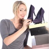 Blonde Woman Holding Boxes Of Shoes