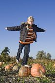 Children On Pumpkin Field
