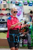Carnival Worker Blows Bubbles With Bubble Guns