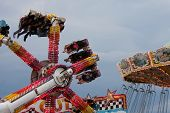 People Enjoy Scary Carnival Ride At Fair