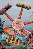 Teens Enjoy An Upside Down Carnival Ride