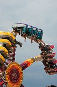 Teens Enjoy Inverted Carnival Ride At Fair