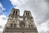 stock photo of damme  - Notre Damme view from underneath on a cloudy day in Paris - JPG