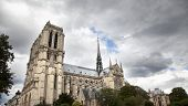 image of damme  - horizontal and panoramic view of Notre Damme on a cloudy day in Paris - JPG