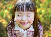 pic of playgroup  - Portrait of beautiful young girl smiling in the park - JPG