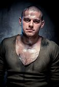 Portrait Of Muscular Young Man With Dirty Face And Chest