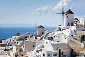 Traditional Windmills In Village Oia Of Cyclades Island Santorini Greece