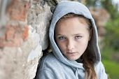 stock photo of homeless  - Little homeless child feels desparete in the street - JPG